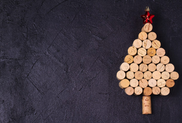 Christmas tree made of  wine corks. Mockup, layout, flat lay. New Year winter season concept, background